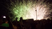 TARRAGONA, SPAIN - CIRCA JULY 2016 - People watch fireworks and record it on smartphones.