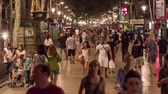 BARCELONA, SPAIN - CIRCA JULY 2016: Timelapse while people walk on La Rambla street.
