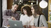 Pretty Young People In A Team Working On A Project In A Coffee Bar Passing Tablet Trendy New Work Environment Concept Slow Motion Shot