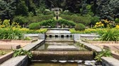 garden paths : Time lapse of the fountain in the flower gardens of Villa Toeplitz on sunny spring day, Varese, Italy.