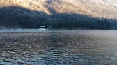 blussen : Ghirla, Varese, Italy - January, 7 2019: Firefighters helicopter take water in the lake in a mountain lake above Ghirla in Valganna, province of Varese, Italy Stockvideo
