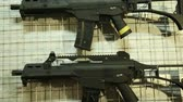 recon : Airsoft guns hunging on the bench close up.