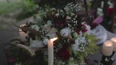 petal : Burning candles and a bouquet of flowers. Stock Footage