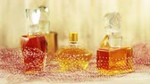 perfume : Ancient bottles of perfume on the wooden surface covered with the veil