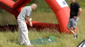 offers : Tseleevo, Moscow region, Russia - July 24, 2014: Free golf lessons in the Tseleevo Golf & Polo Club during the M2M Russian Open. Golf Academy in the club offers the lessons for beginners