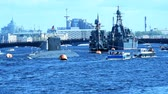 first : St. Petersburg Russia  May 9 2015: People on trip boats watch the submarine and warships participating in the naval parade dedicated to the Victory Day. This is the first time the naval parade included in the Victory Day celebrations in St. Petersburg Stock Footage