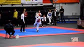 árbitro : St. Petersburg, Russia - October 17, 2015: Children compete in the individual taekwondo tournament during the martial arts festival Baltic Sea Cup in Sibur Arena. The traditional festival is organized by martial arts school of Demid Momot