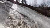 tumultuous : Ivangorod, Leningrad oblast, Russia - March 29, 2016: Water discharge at Narvskaya Hydroelectric Power Plant. Built in 1956 at the border between Russia and Estonia, it has nameplate capacity 125 MW Stock Footage