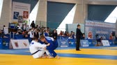 concorrentes : St. Petersburg, Russia - April 16, 2016: Fight Leon Philipp of Germany vs Dmitry Karpukhin of Russia during the Junior European Judo Cup. 346 athletes from 22 countries participated in the competition