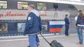 first : St. Petersburg, Russia - May 28, 2016: Passengers at the double-decker train Mikhail Ulyanov in the day of its first departure from St. Petersburg to Adler. The train is operated by Russian Railways Stock Footage