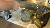 unclean : dirty dishes in the kitchen sink at home