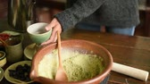 чай : people make the famous Pounded Tea, Hakka Traditional Beverage