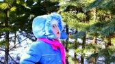 playful : Little girl walking outdoor in the winter pine forest