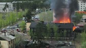 pojistné : Wooden residential house in fire. Russia