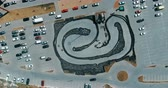 gokart : Aerial top view on the parking with karting place. Shoot from copter drone. 4K video