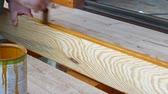 durability : Footage of a man applying a wood protective fluid to a timber for a better durability... Stock Footage