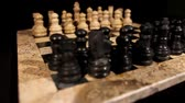 checkmate : Chess board with its figures lined up,focus goes from black to white figures...