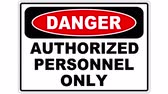 proibir : An authorized personel only sign, the shot is coming into focus and goes again out of focus