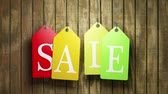 coloured background : Colorful sale tags hanging on wooden background. Seamless loop. Stock Footage