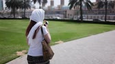 charming : a girl tourist in a headscarf Stock Footage