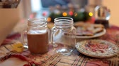 hilkat garibesi : Two mugs with cocoa and marshmallows are on the Christmas table. Stok Video