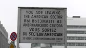 exército : BERLIN,GERMANY- NOVEMBER 18:Checkpoint Charlie, border between the two Germany, in a short time has become a major tourist attraction on Nov 18, 2012 in Berlin, Germany Vídeos