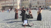 celta : PRAGUE - AUGUST 4: Street performers in costume play Celtic in  Old Town Square or Clocks square on august 4,2015 in Prague - Czech Vídeos