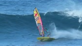 marcha : MAUI, HI - MARCH 13: Professional windsurfer Kai Lenny rides a large ocean wave. March 13, 2011 in Maui, HI. Vídeos