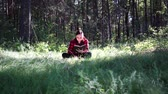 conhecimento : Young handsome woman reading book in open space Stock Footage
