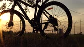 cyklista : Beautiful close up scene of bicycle at sunset, sun on blue sky with vintage colors, silhouette of bike forward to sun.