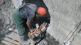 consequence : Builder repairing a manifold using steel disc saw
