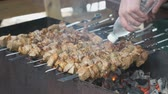 broiling : Cooking of pork shashlik on skewers on the grill outdoors. Close up