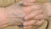 dobrado : Old woman hand with wrinkled skin. Close up
