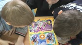kitapçık : MOSCOW, RUSSIA - SEPTEMBER 7, 2016: Children reading a book in a classroom. Close-up Stok Video