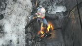say goodbye : Burn doll on Shrovetide. Russian holiday Maslenitsa. Burning small doll on bonfire Stock Footage