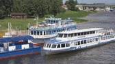 vezetett : VELIKIY NOVGOROD, RUSSIA - JUNE 22, 2017: Panoramic view of ship with tourists floating on the Volkhov river to pier Stock mozgókép