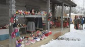 VELIKIY NOVGOROD, FEBRUARY 25, 2017: Celebration of Shrovetide carnival in Vitoslavlitsy. Shopping tent with assortment of traditional Russian baby toys handmade
