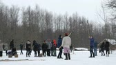 VELIKIY NOVGOROD, FEBRUARY 25, 2017: Celebration of Shrovetide carnival in Vitoslavlitsy museum of wooden architecture. People play Russian folk games on street of village
