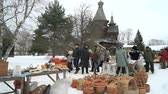 VELIKIY NOVGOROD, FEBRUARY 25, 2017: Celebration of Shrovetide carnival in Vitoslavlitsy. Shopping tent with assortment of traditional Russian caskets of birch bark in Russia
