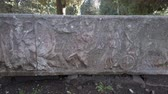 刻まれた : Close up view of the ancient Roman sarcophagus located in the archaeological excavations of Ostia Antica - Rome, Italy 動画素材