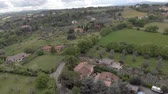 stodola : Aerial view of flying over the countryside, olive groves and fruit trees