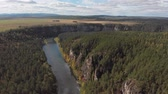 gut : Slow direct aerial flight over a gentle mountain river, pine forest. Ay river. Stock Footage