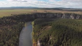 bashkortostan : Slow direct aerial flight over a gentle mountain river, pine forest. Ay river. Stock Footage