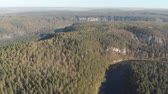bashkortostan : Slow aerial flight backwards over a gentle mountain river, pine forest, clouds. Stock Footage