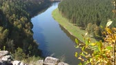 bashkortostan : Static view from a mountain to a slow river and pine forest