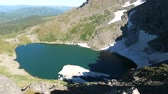 западный : Static view to mountain lake with floe. Altai