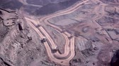 Dump trucks and other vehicles in a Copper mine