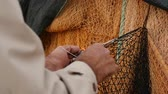 The fisherman repairs the fishing net. Stock Footage