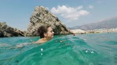 young woman is swimming in the Adriatic Sea Stock Footage