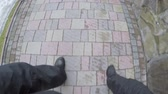 male feet in shoes go on paving stones Стоковые видеозаписи